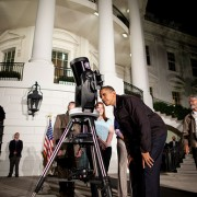 President Obama looks through a telescope during the 2009 White House Astronomy Night. (Photo credit Chuck Kennedy)